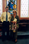 mom & me at Short Cross Methodist church - shows the flowers & cards rec'd for her 80th birthday